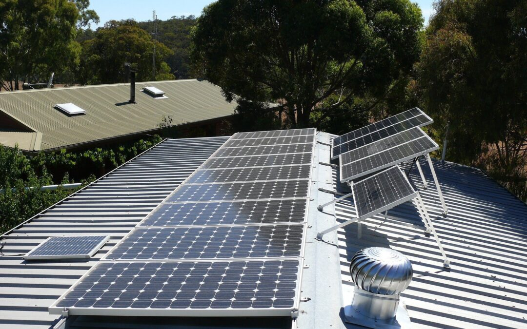solar panels on top of corrugated roof above house