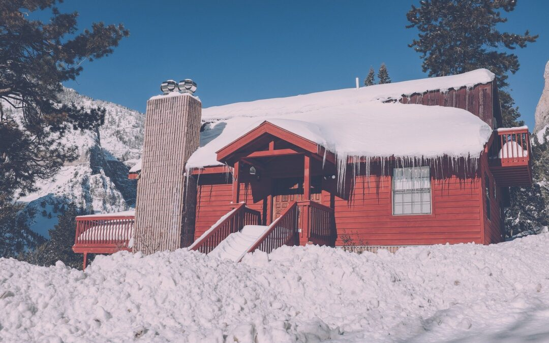 red house covered in snow and ice