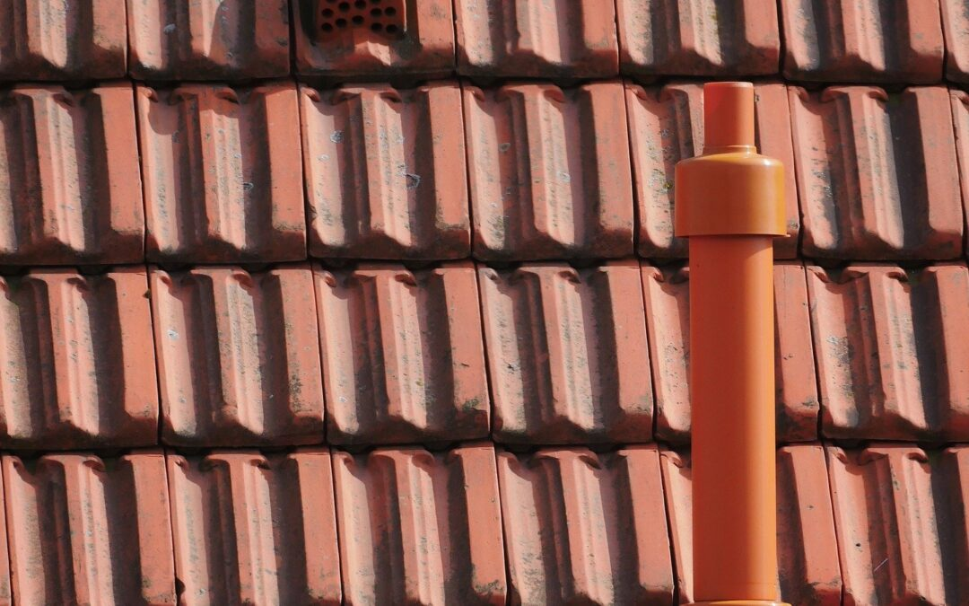 close up of vent pipe on a steep red roof